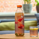 Bottle PET clear 1000cc with orange cap